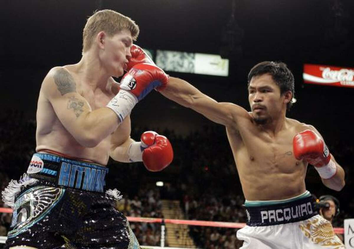 Manny Pacquiao throws a right to the head of Ricky Hatton in the first round of their junior welterweight title match.
