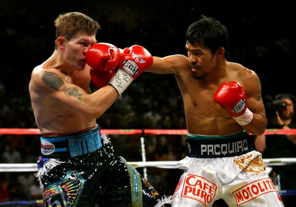 Manny Pacquiao connects with a right to the face of Ricky Hatton in the first round of their junior welterweight title fight at the MGM Grand Garden Arena.