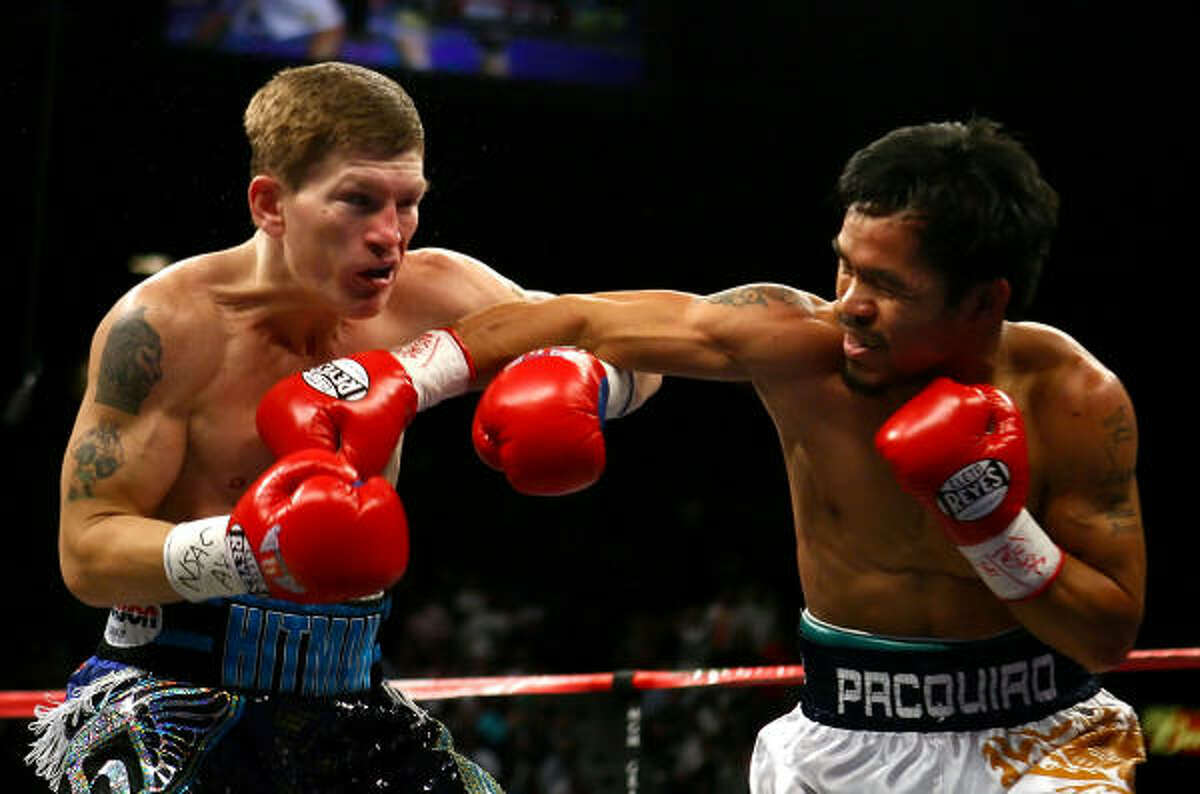 Manny Pacquiao follows through on a right to Ricky Hatton.