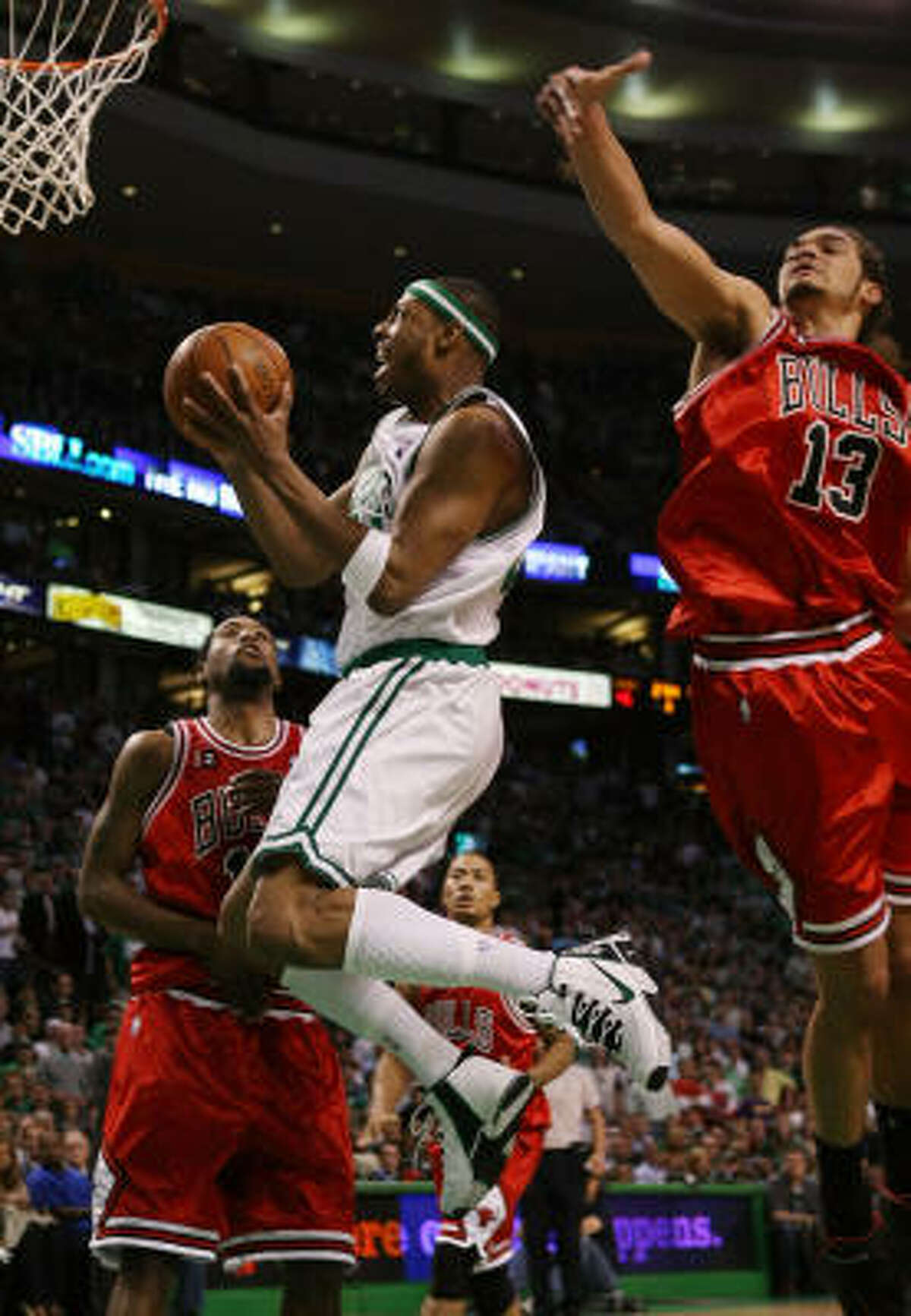 Boston's Paul Pierce (center) goes up for a shot between Chicago's John Salmons (left) and Joakim Noah in Game 7 of their Eastern Conference first-round playoff series Saturday. Boston won 109-99 to claim the best-of-seven series and advances to the second round to face the Orlando Magic.