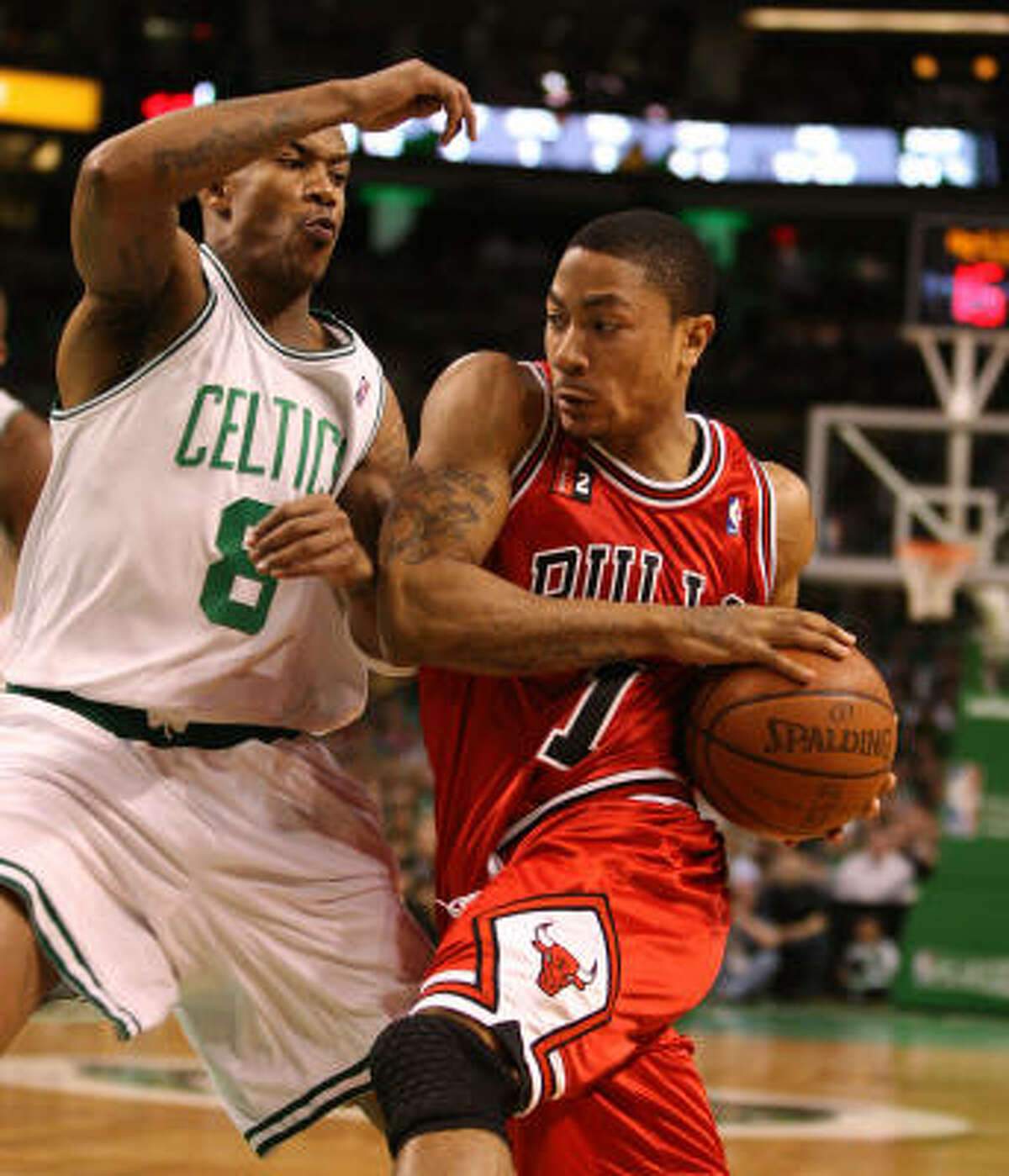Chicago's Derrick Rose drives to the basket while being guarded by Boston's Stephon Marbury during the first quarter.