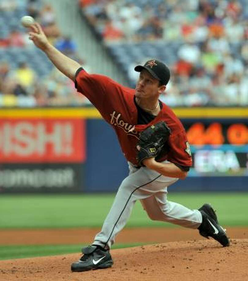 Roy Oswalt started against the Braves. Due to the rain delay during the second inning, Oswalt pitched one inning. Photo: Gregory Smith, AP