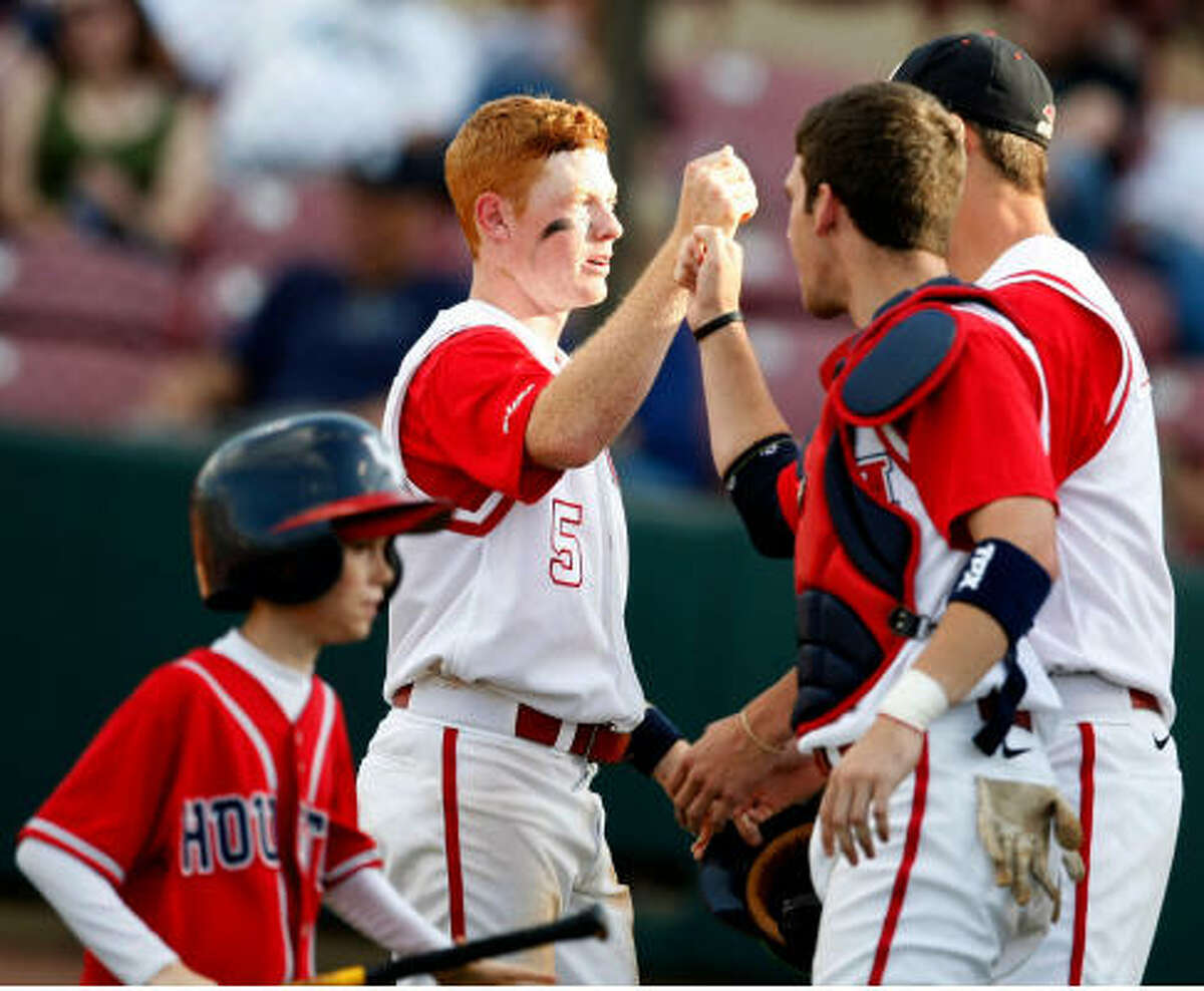 University of Houston second baseman Blake Kelso, left center, is congratulated for scoring in the first inning.