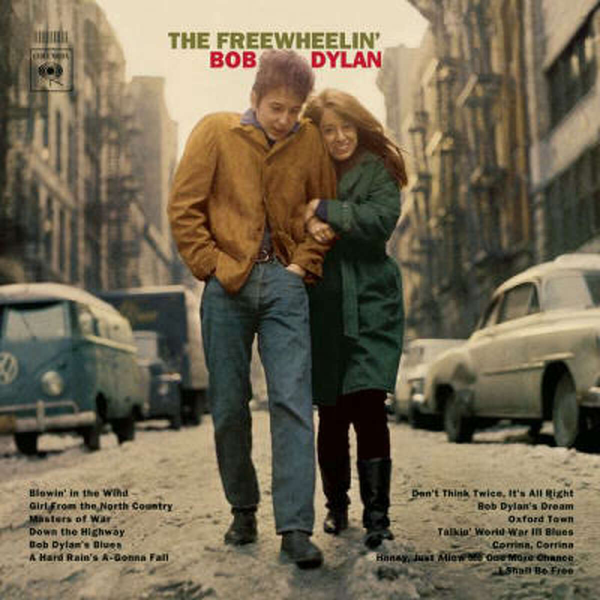 The Freewheelin' Bob Dylan (1963): Pictured smiling and locking arms with then girlfriend Suze Rotolo, scampering around New York's Greenwich Village in February. Paul Till, who would provide the cover shot for Blood on the Tracks years later, calls it