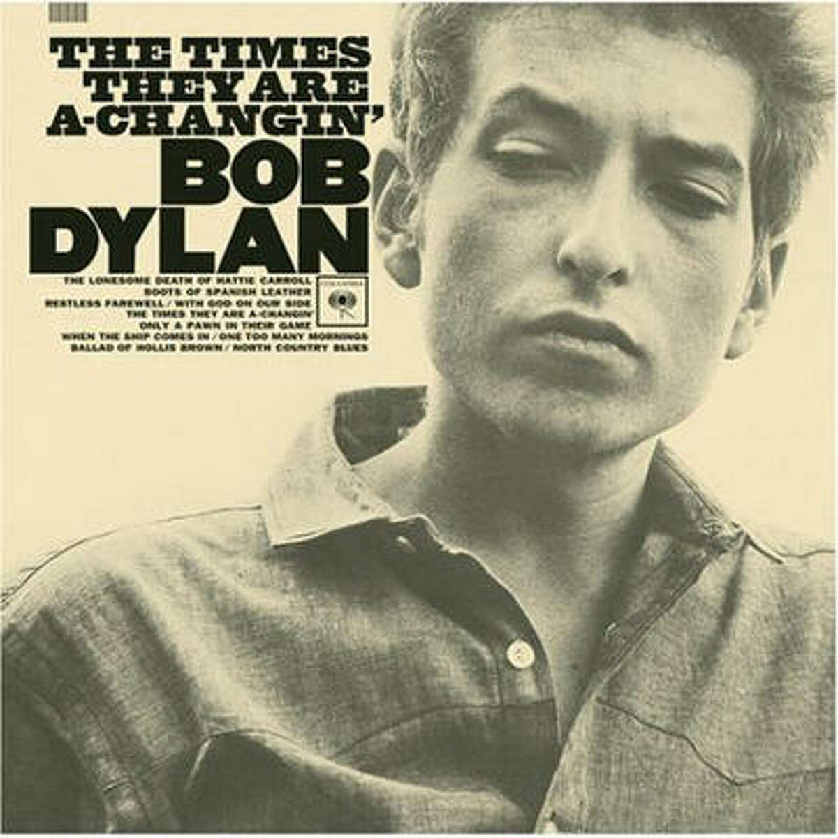 The Times They Are a Changin' (1964): His first set of all original songs and he seems serious about it. He looks gaunt like a bluesman, contemplative, and perhaps in a foul mood.