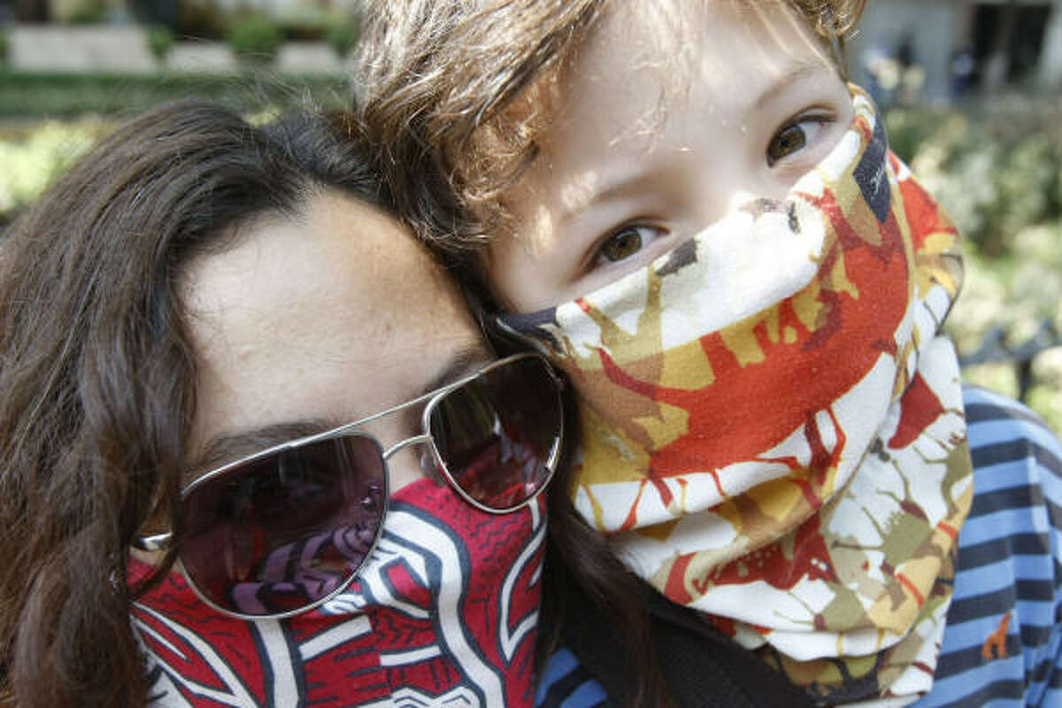 MEXICO CITY Lirice Zuniga, 38, left, and her 7-year-old son Luka Barrena, April 2009