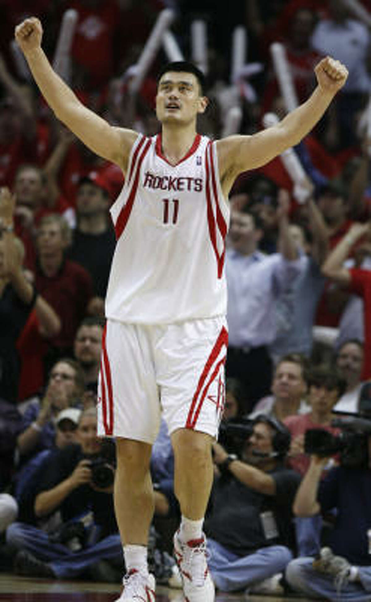 Rockets center Yao Ming celebrates during the fourth quarter in Game 6.