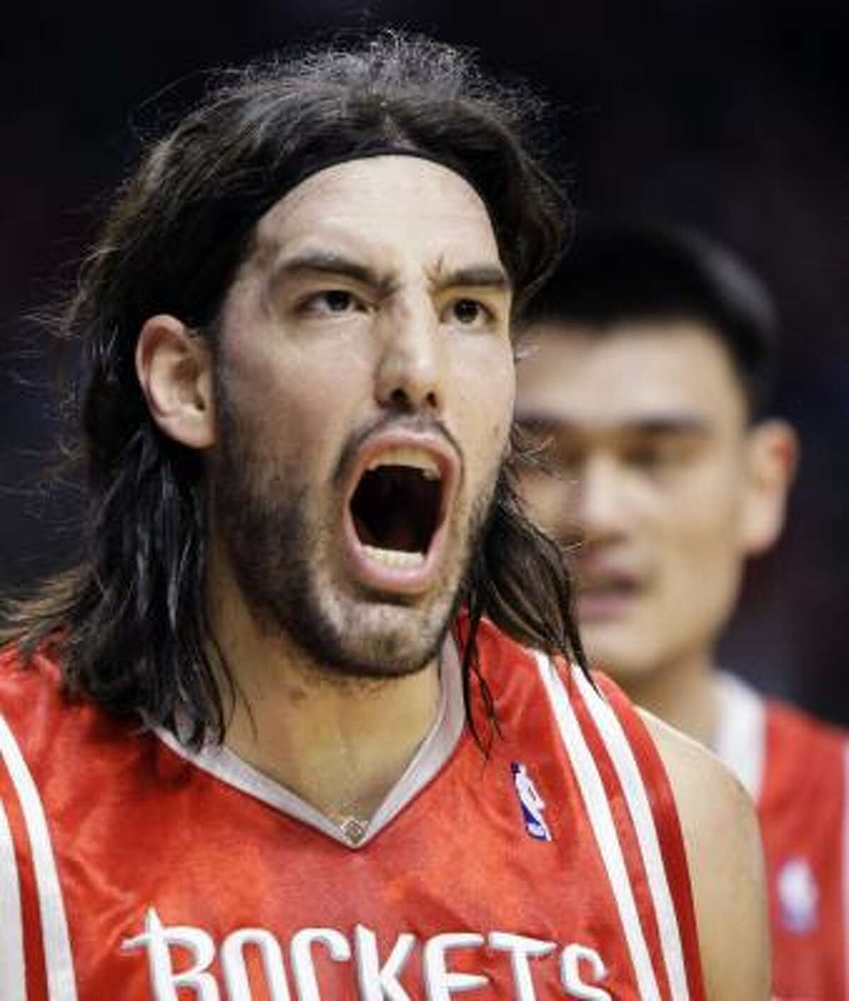 Rockets' Luis Scola, shouts after being fouled by Trail Blazers' Greg Oden.