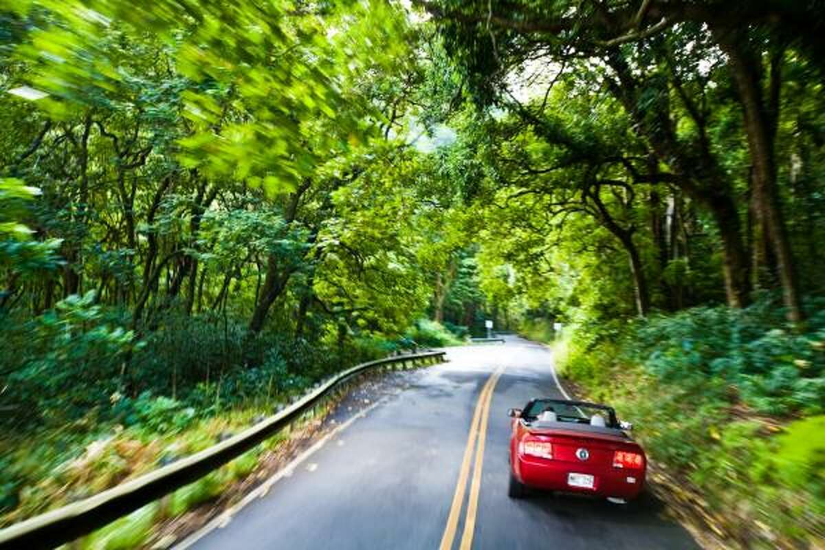 The road to Hana is a gorgeously tortuous, 52-mile, 54-bridge, 617-curve road from Wailuku, with frequent halts to gawk at waterfalls and rainbows.
