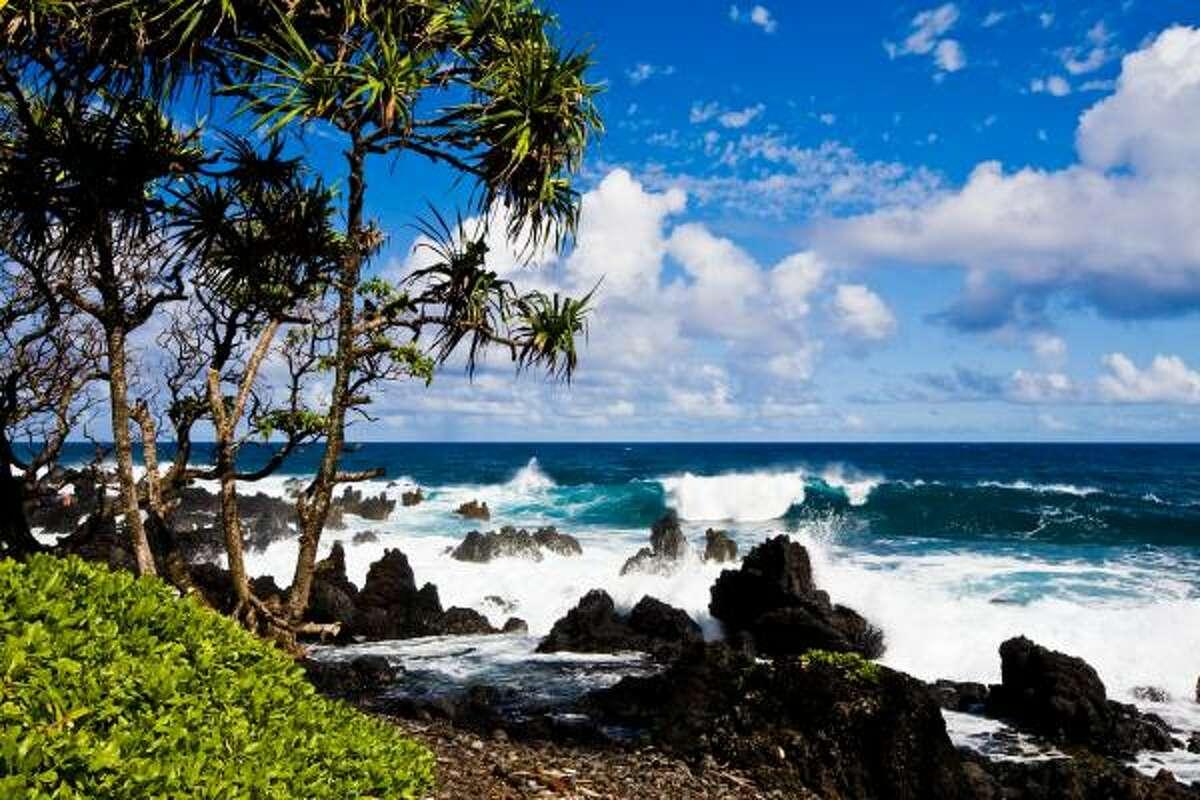 Waves break near a black-sand beach. The black-sand beaches near Hana are among the finest in the world.