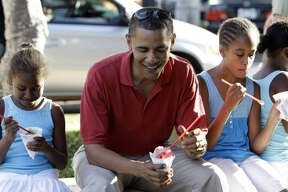 President Barack Obama shared shave ice with daughters Sasha, left, and Malia while vacationing in Hawaii during the 2008 campaign.