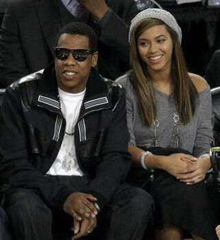 Beyonce and her man at a basketball game. Photo: Matt Slocum, AP