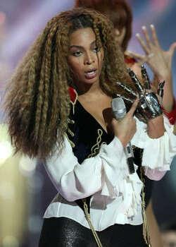 Beyonce with her Michael Jackson impersonation. Photo: Claude Paris, AP