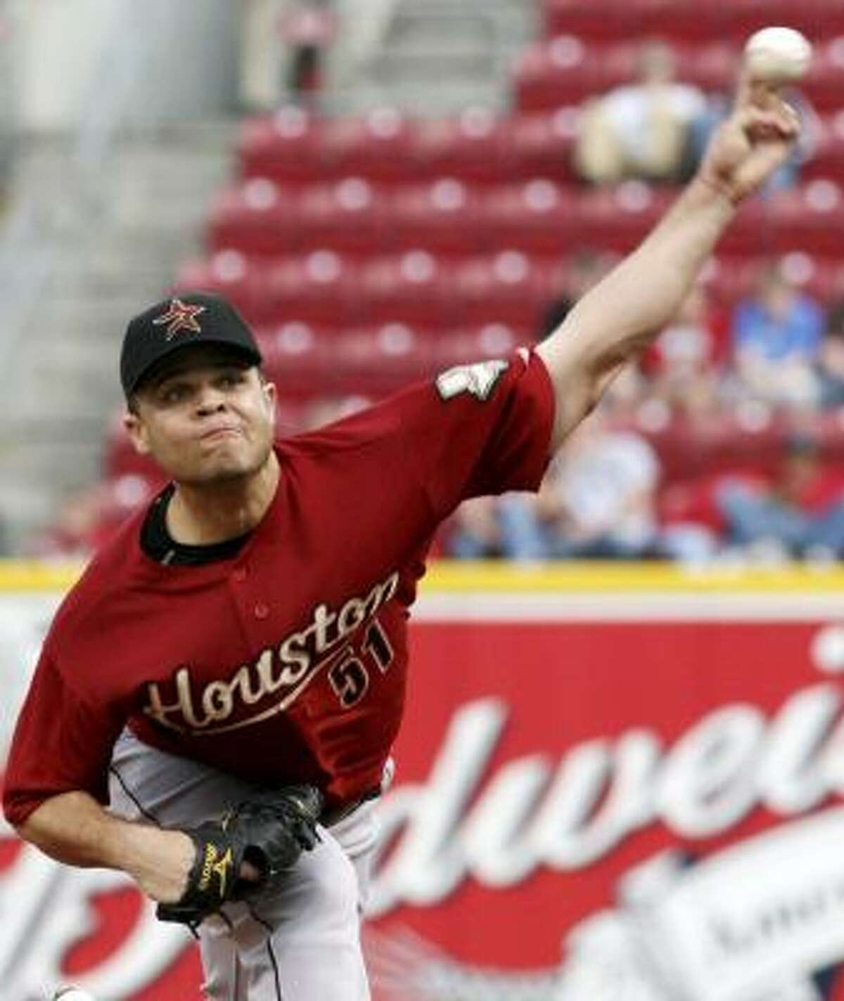 Astros' Wandy Rodriguez pitches against the Cincinnati Reds in the first inning.