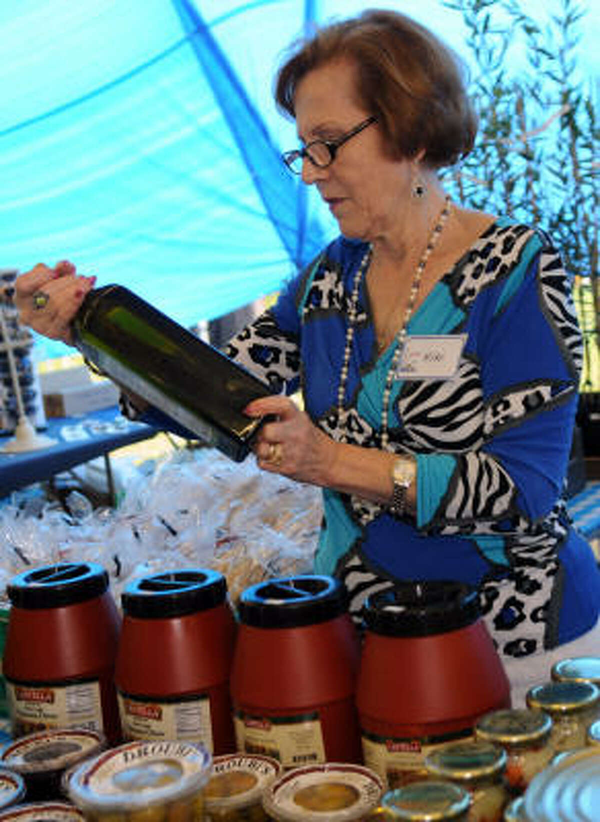 Kiki Pantazis looks over some olive oil for sale at the 16th annual Clear Lake Greek Festival at Clear Lake Park.