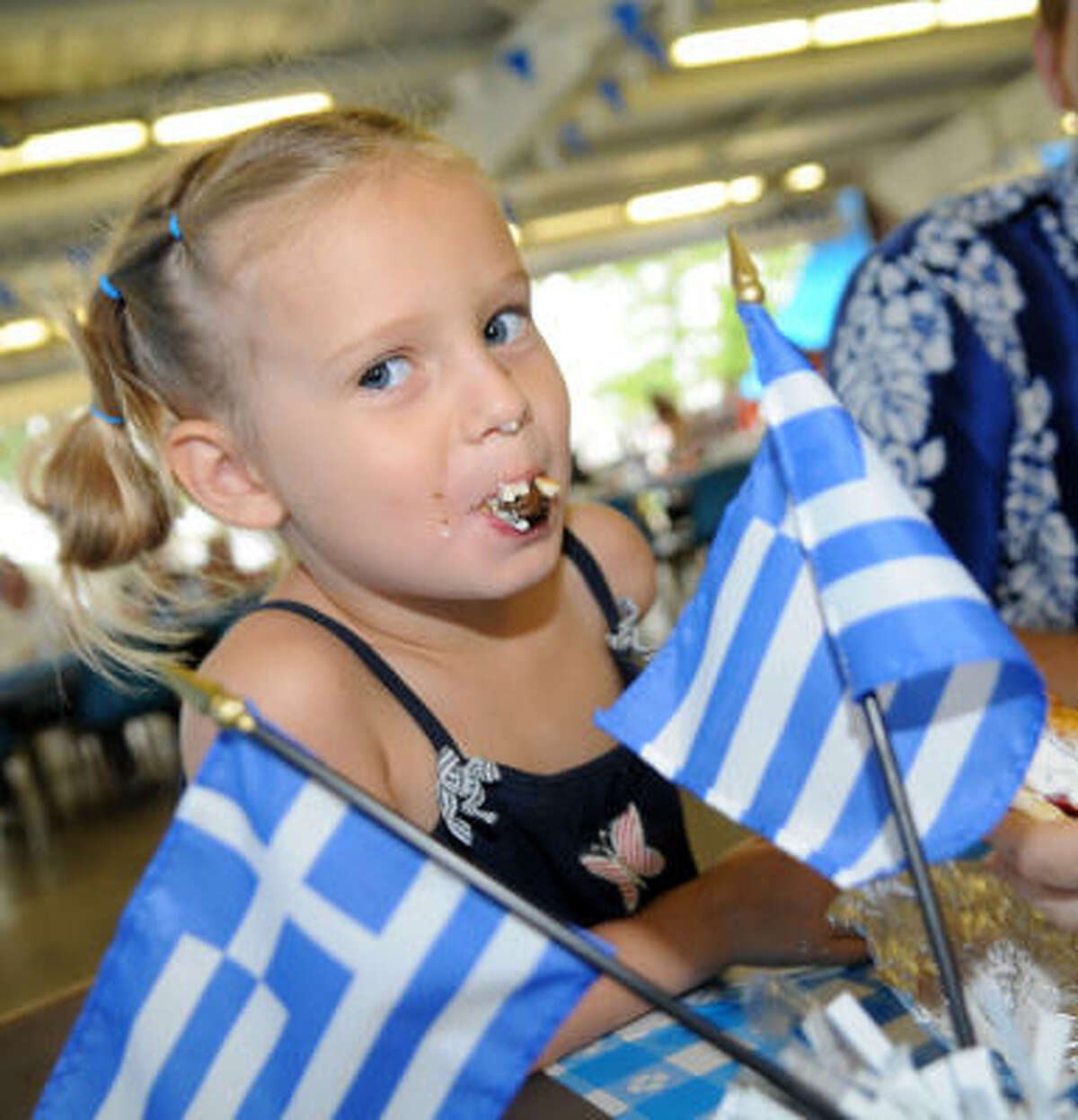 Emily Smith, 5 enjoys Greek food at the festival.