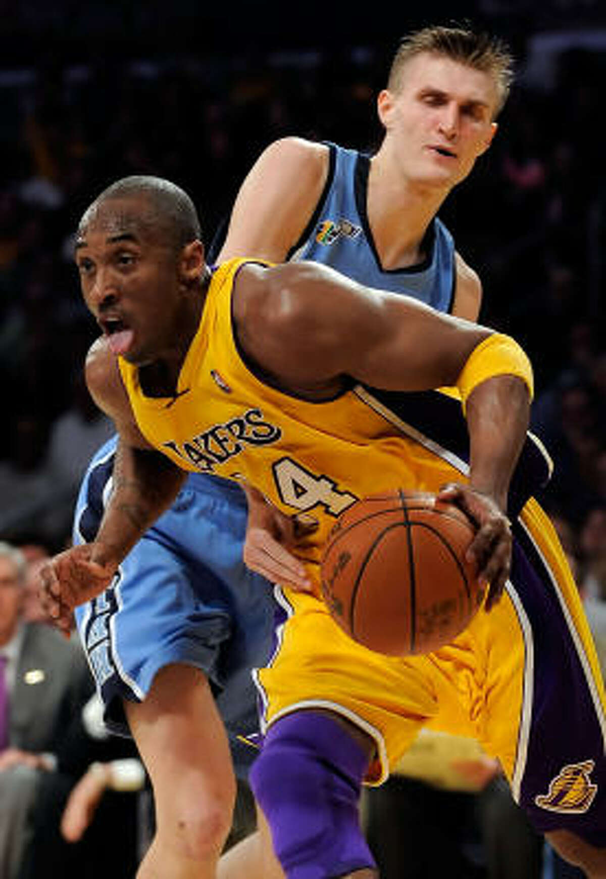 Los Angeles Lakers guard Kobe Bryant (front) drives past Utah's Andrei Kirilenko in the second quarter of Game 5 of their Western Conference playoff series. The Lakers won 107-96 to clinch the series, 4-1.