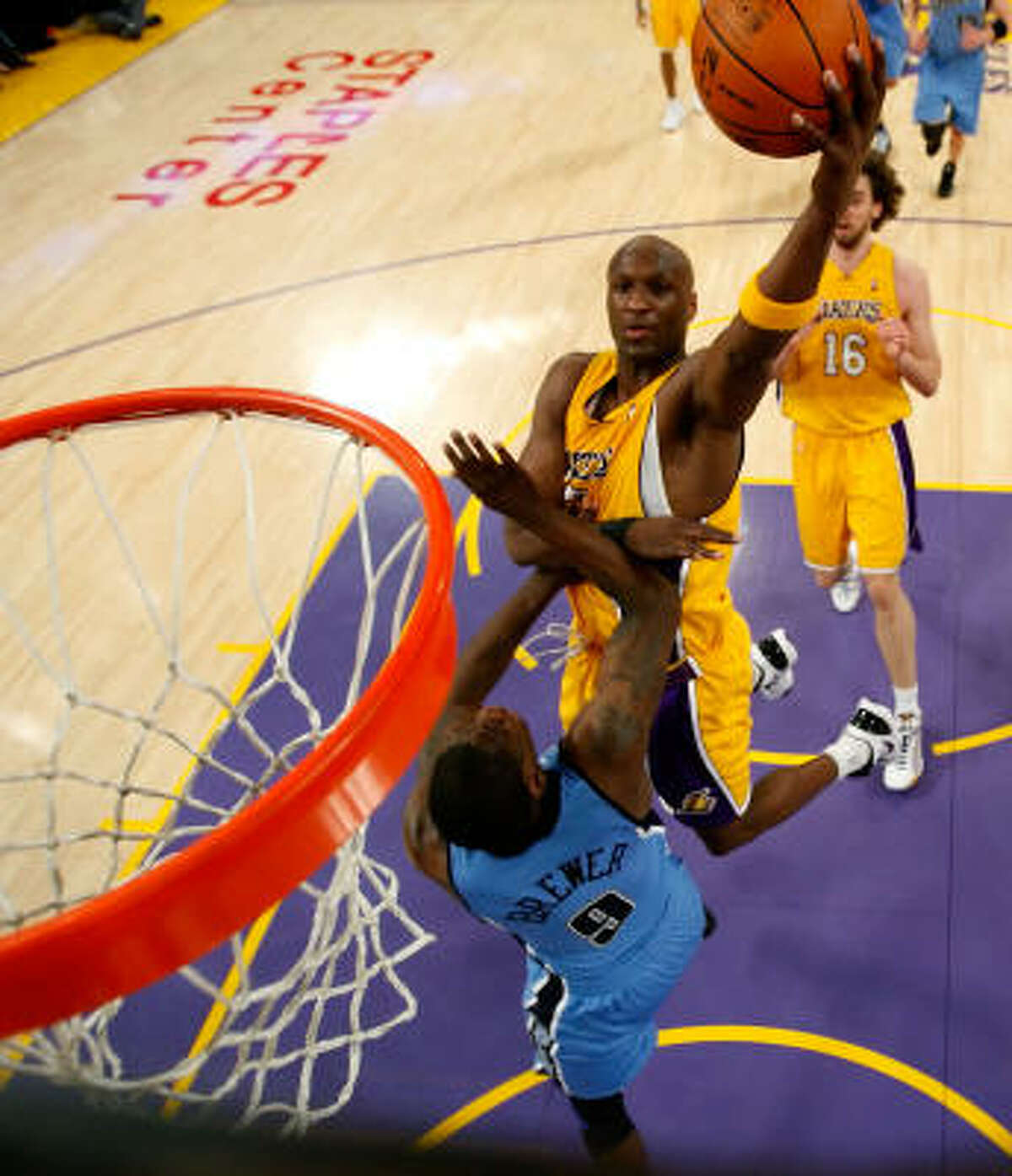 Los Angeles' Lamar Odom goes up for a shot over Utah's Ronnie Brewer in the first half.