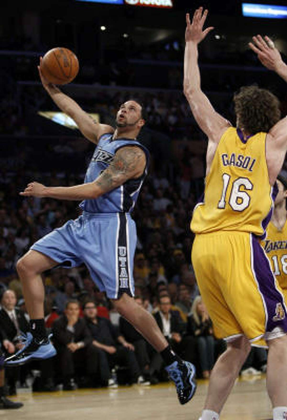 Utah's Deron Williams, left, takes a shot over Los Angeles' Pau Gasol during the first half.