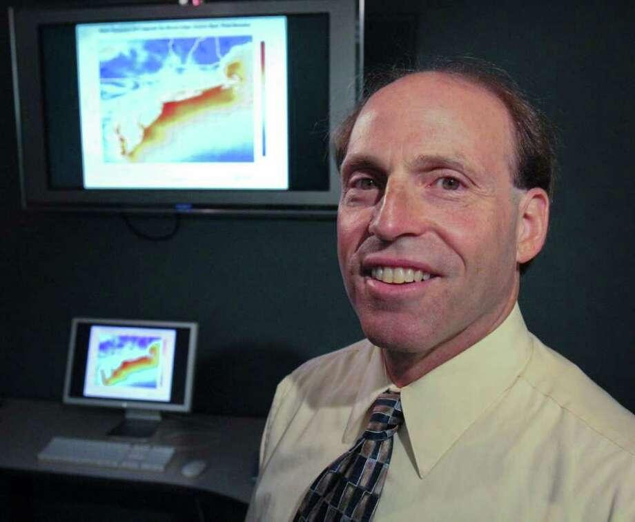 Jeff Freedman, Lead Research Scientist at AWS Truepower, stands in front of a model simulation of composite sea breeze cases in the Albany office on Monday, August 1, 2011. (Erin Colligan / Special To The Times Union)