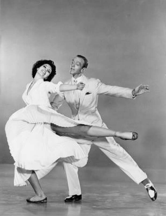 During the Depression people wanted to see glamour and escape into fantasies, like Fred Astaire dancing on a ceiling. Photo: Hulton Archive, Getty Images