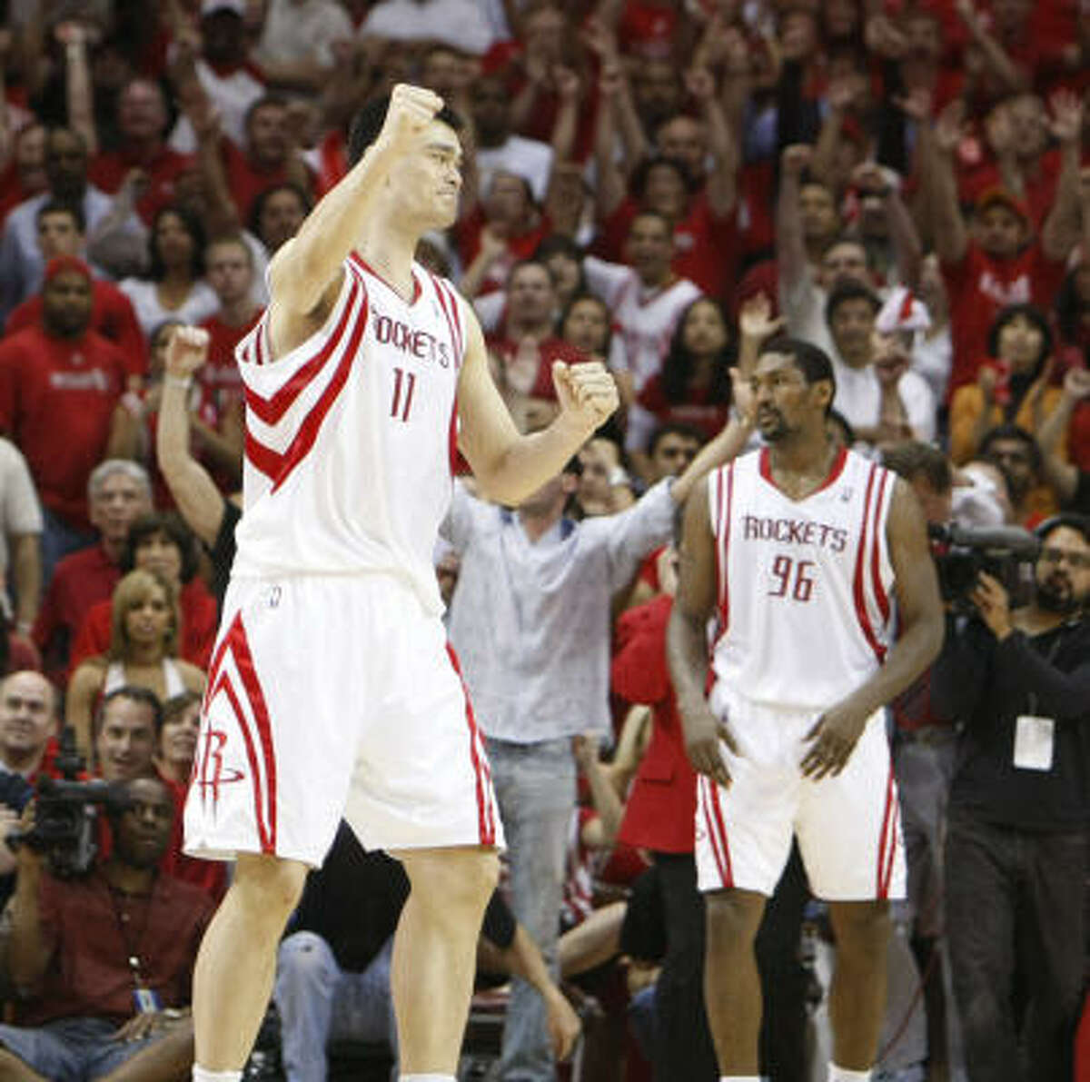Rockets center Yao Ming (11) celebrates as the horn sounds ater beating the Portland Trail Blazers 89-88.