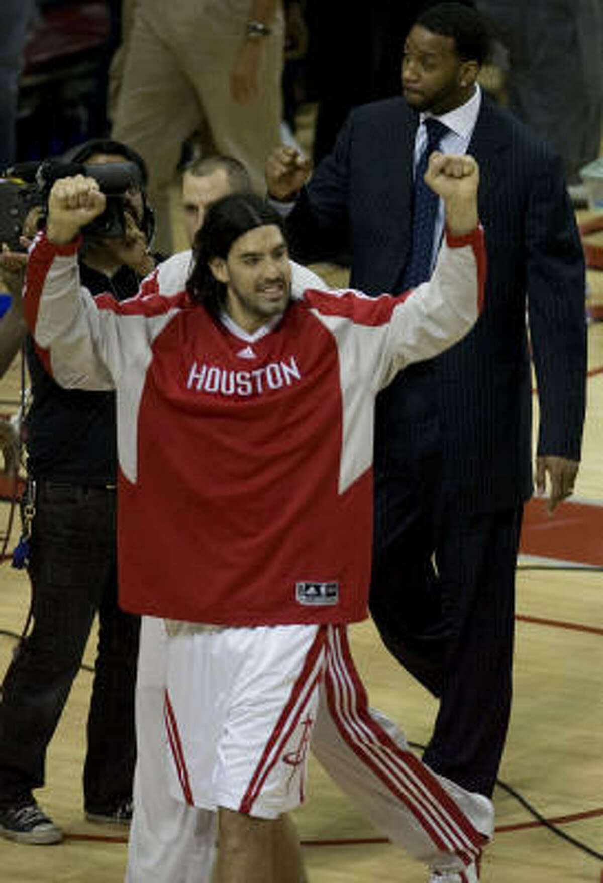 Rockets forward Luis Scola (front) and Tracy McGrady (rear) celebrate after defeating the Portland Trail Blazers during Game 4.
