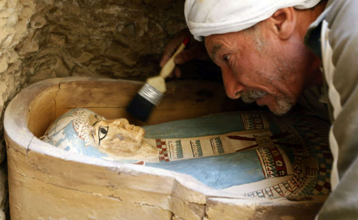 An Egyptian worker brushes an ancient Pharaonic sarcophagus of Illahun mayor's daughter dated to the 22nd Dynasty (ca. 931-725 BC) inside a rock-cut tomb.