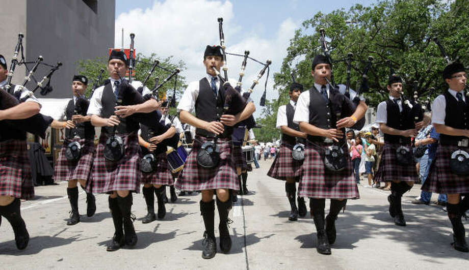 Members of the Saint Thomas' Episcopal School Pipe Band march to the stage for their performance at iFest  the Houston International Festival held downtown. Photo: Melissa Phillip, Chronicle