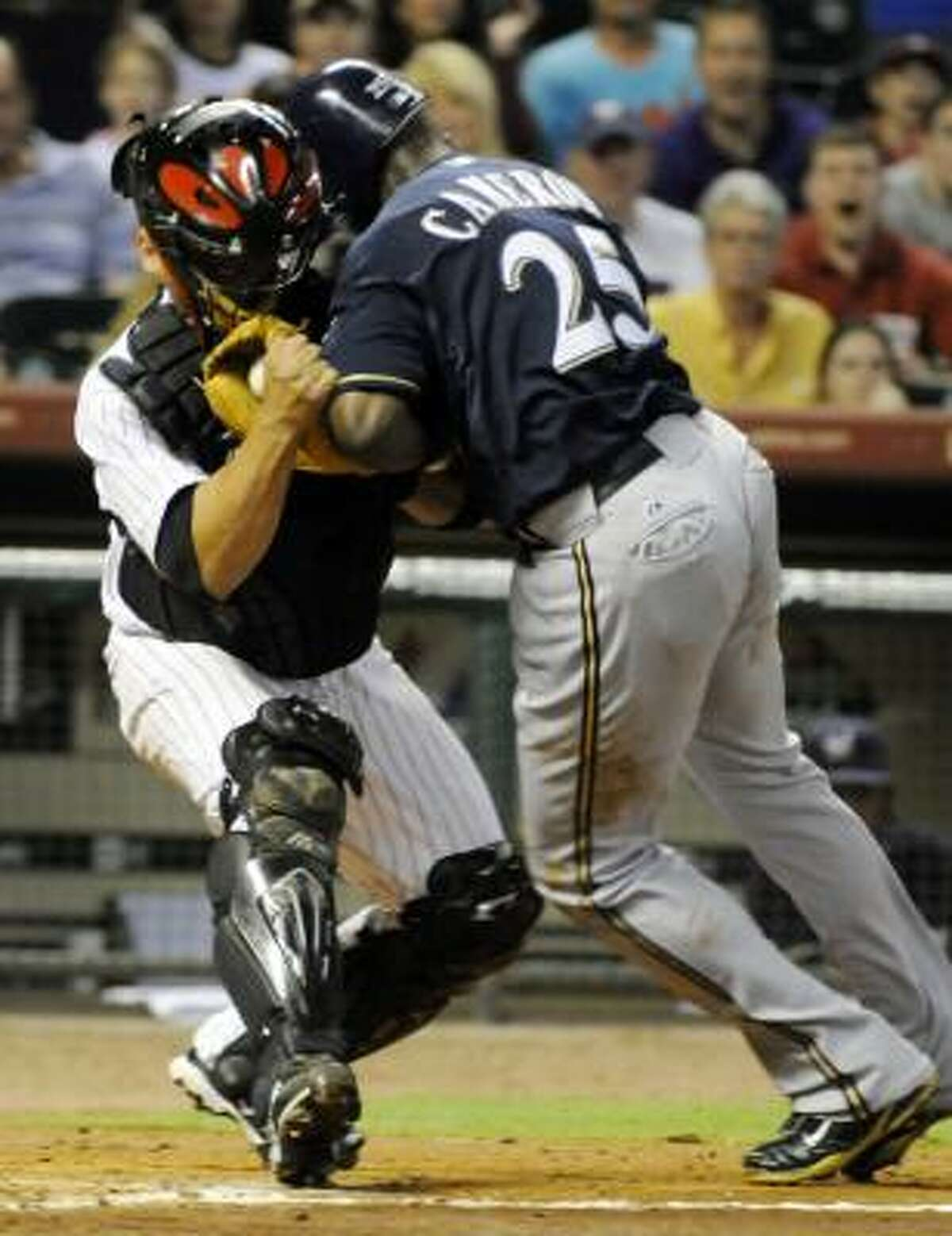 Milwaukee Brewers center fielder Mike Cameron collides with Astros catcher Humberto Quintero at home plate in the fourth inning. Cameron was out on the play and Quintero left the game.