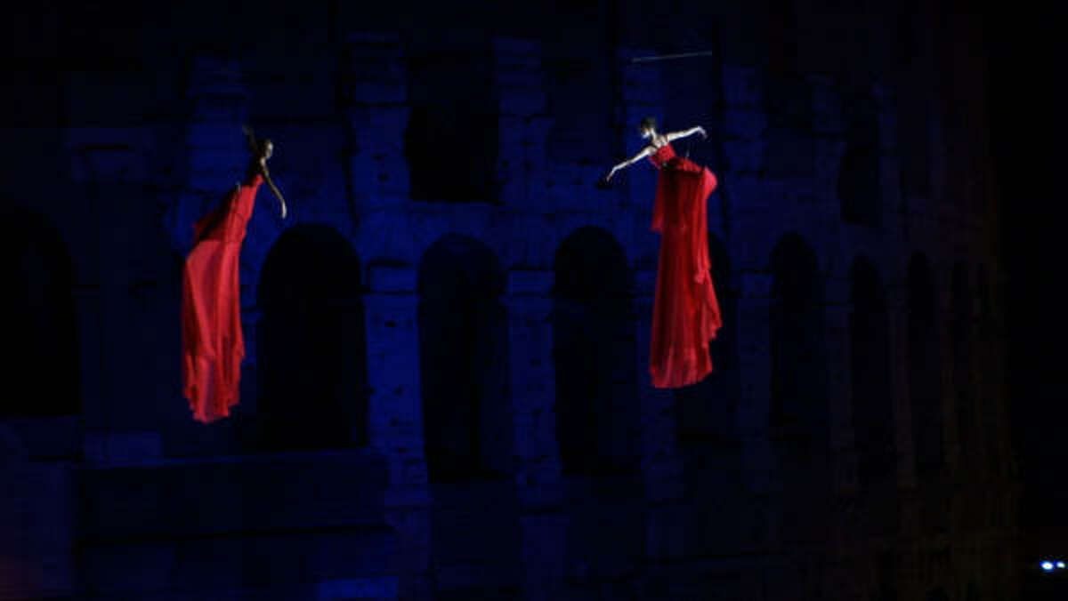 Red dresses flying over the Coliseum were the highlight of the spectacle created by Festi for Valentino's 45th anniversary celebration in Rome July 2007.