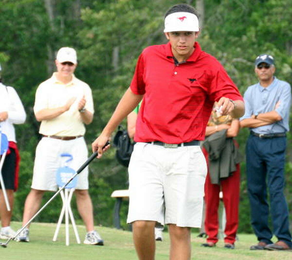 Memorial's Cory Whitsett took the boys crown.