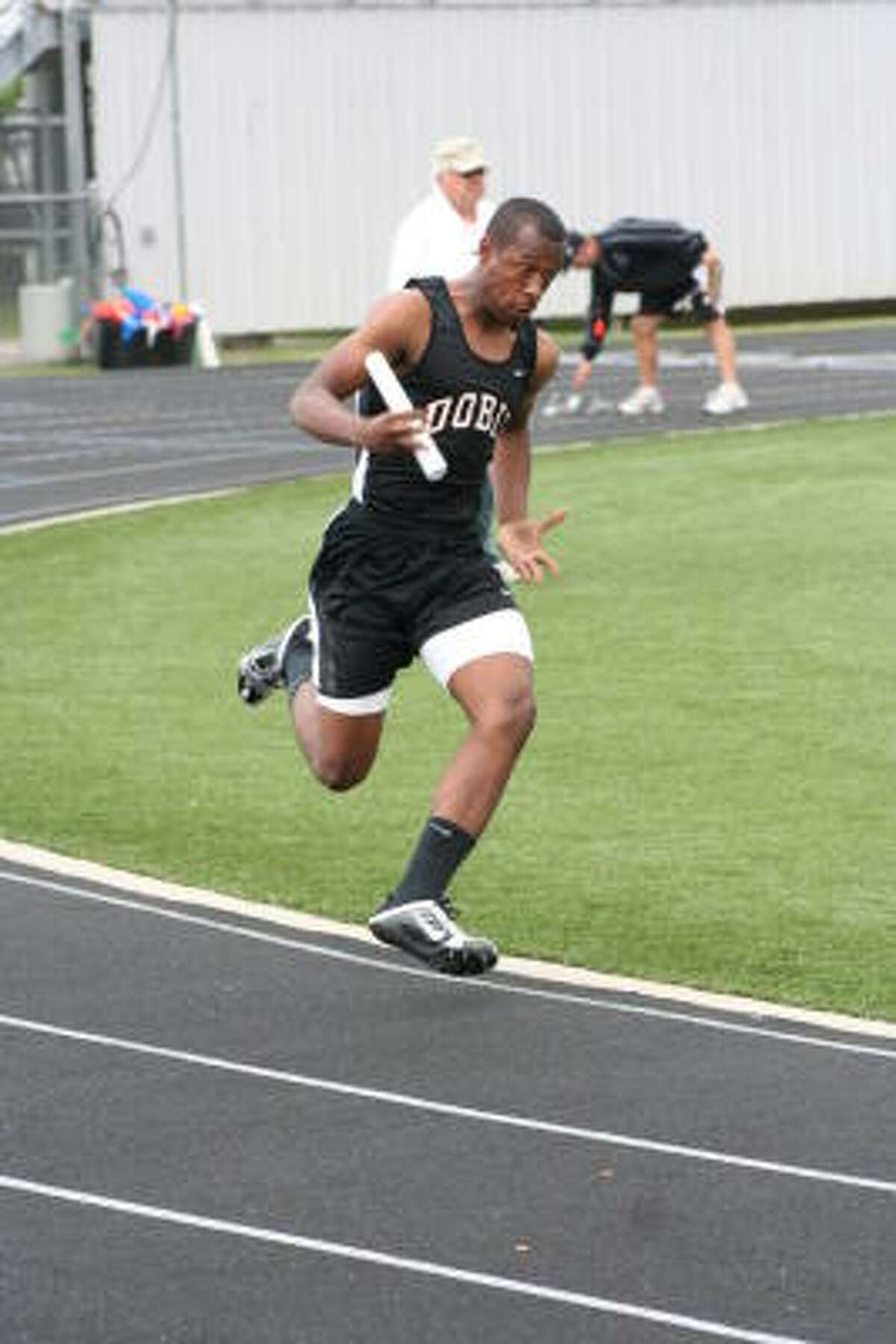 Carl Williams shows off his speed in this relay.