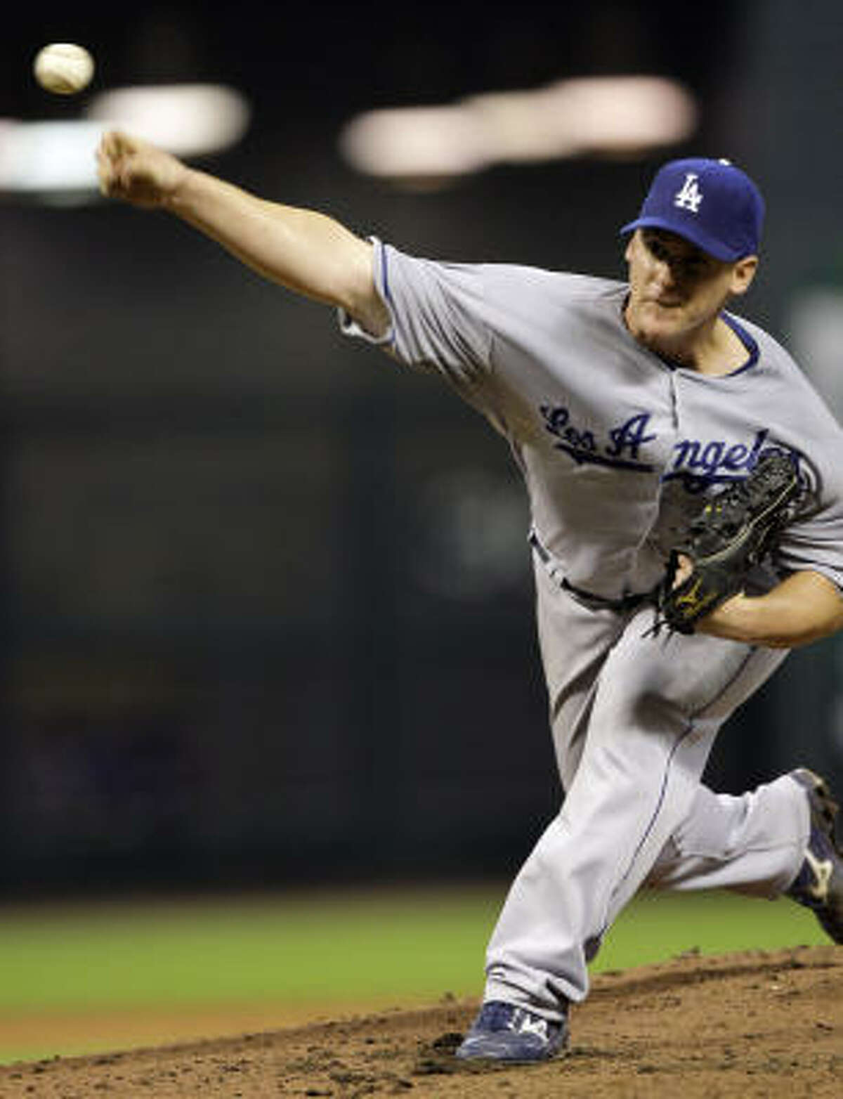 Dodgers starter Chad Billingsley improved to 4-0 after tossing 7 1/3 scoreless innings in Thursday's 2-0 win over the Astros.