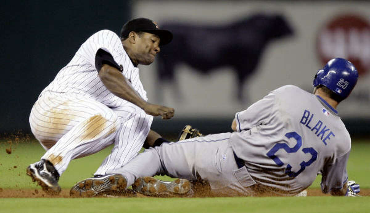 Los Angeles Dodgers' Casey Blake (23) slides into second as Astros shortstop Miguel Tejada falls while making the force-out during the fourth inning of a baseball game