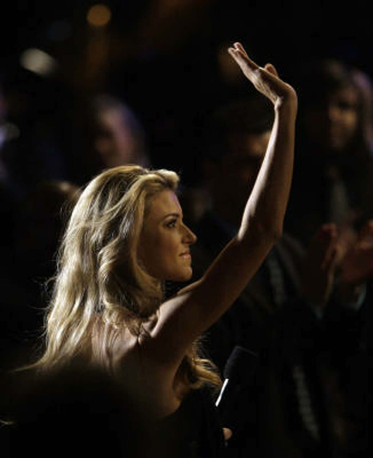 Miss California Carrie Prejean waves to the crowd as she receives a standing ovation during her introduction of a performance at the Dove Awards in Nashville, Tenn., Thursday, April 23.