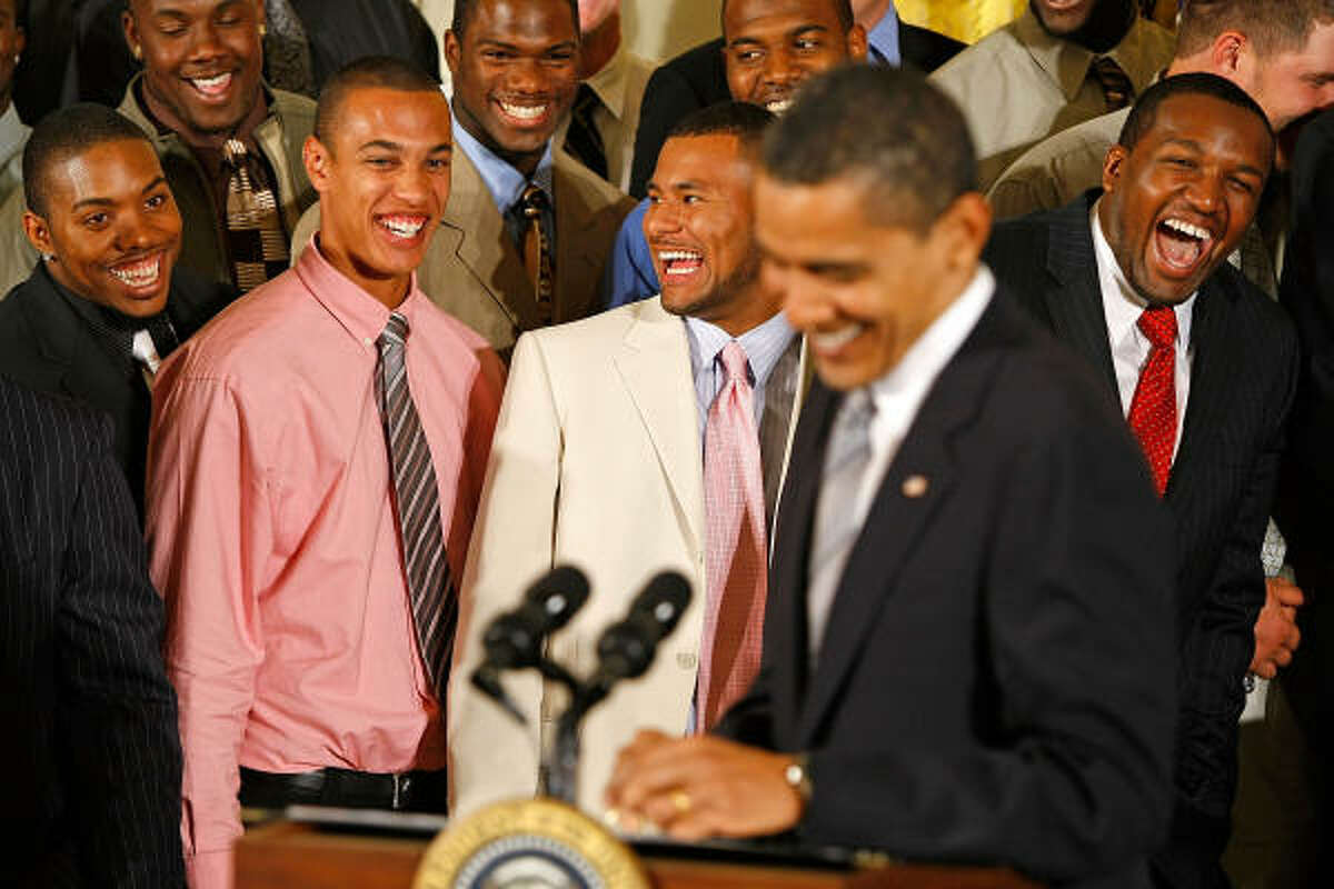 Obama shares a laugh with Florida wide receiver David Nelson, left.