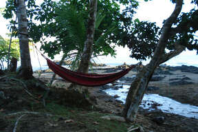 A hammock hangs outside most of the tents at the Corcovado Adventures Tent Camp in Costa Rica. Campers have to make an effort to get to the park.