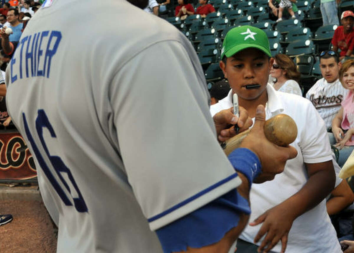 Date: April 22 Game: 2 Fan line: Andre Ethier signs a bat for a young fan.