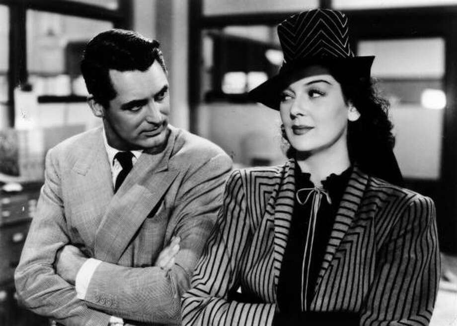 """His Girl Friday: With Cary Grant and Rosalind Russell. Howard Hawks' richly amusing gender-adjusted version of The Front Page — the classic Ben Hecht-Charles MacArthur play about competitive Chicago newspaper writers — solidified the stereotype of raffish reporters as wisecracking, fast-talking cynics who """"comfort the afflicted and afflict the comfortable."""" Photo: PHOTOFEST"""