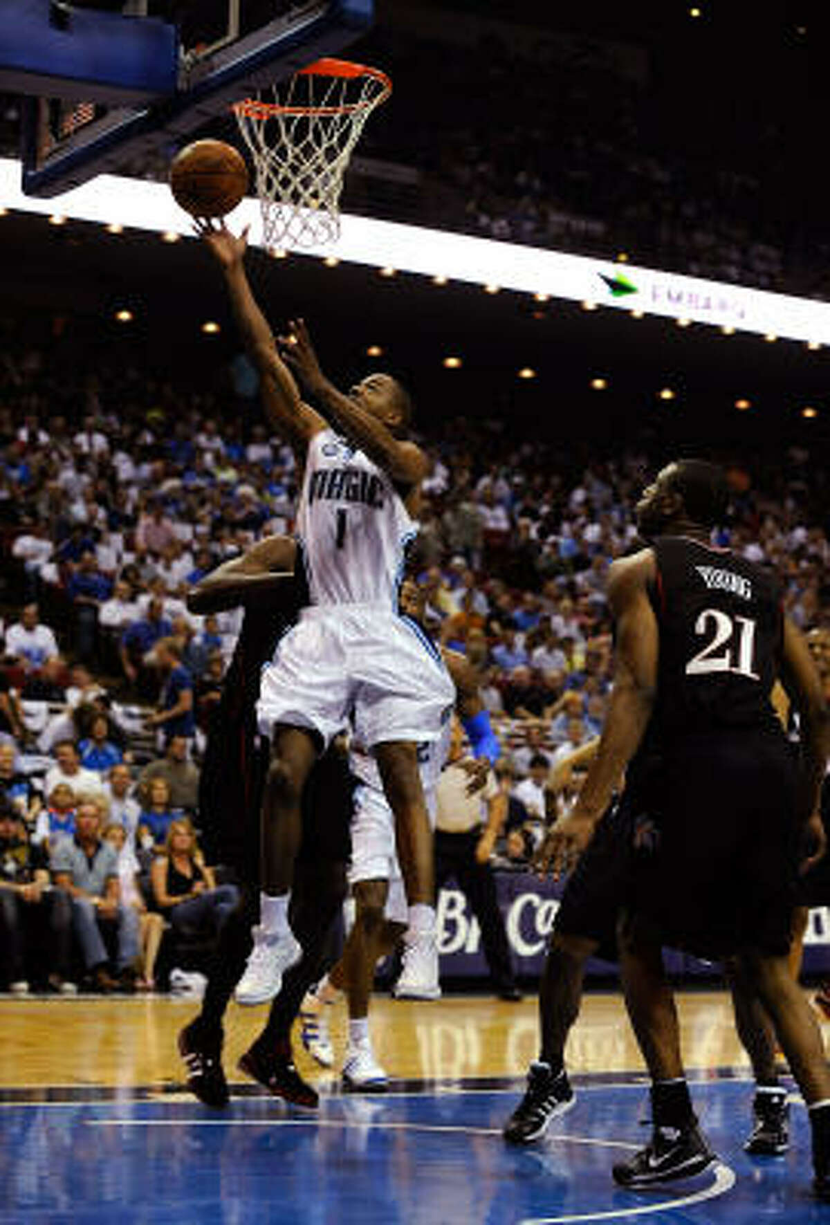 Rafer Alston of the Orlando Magic drives to the basket against Thaddeus Young of the Philadelphia 76ers. The Magic beat the Sixers 96-87 to make the series tied 1-1.