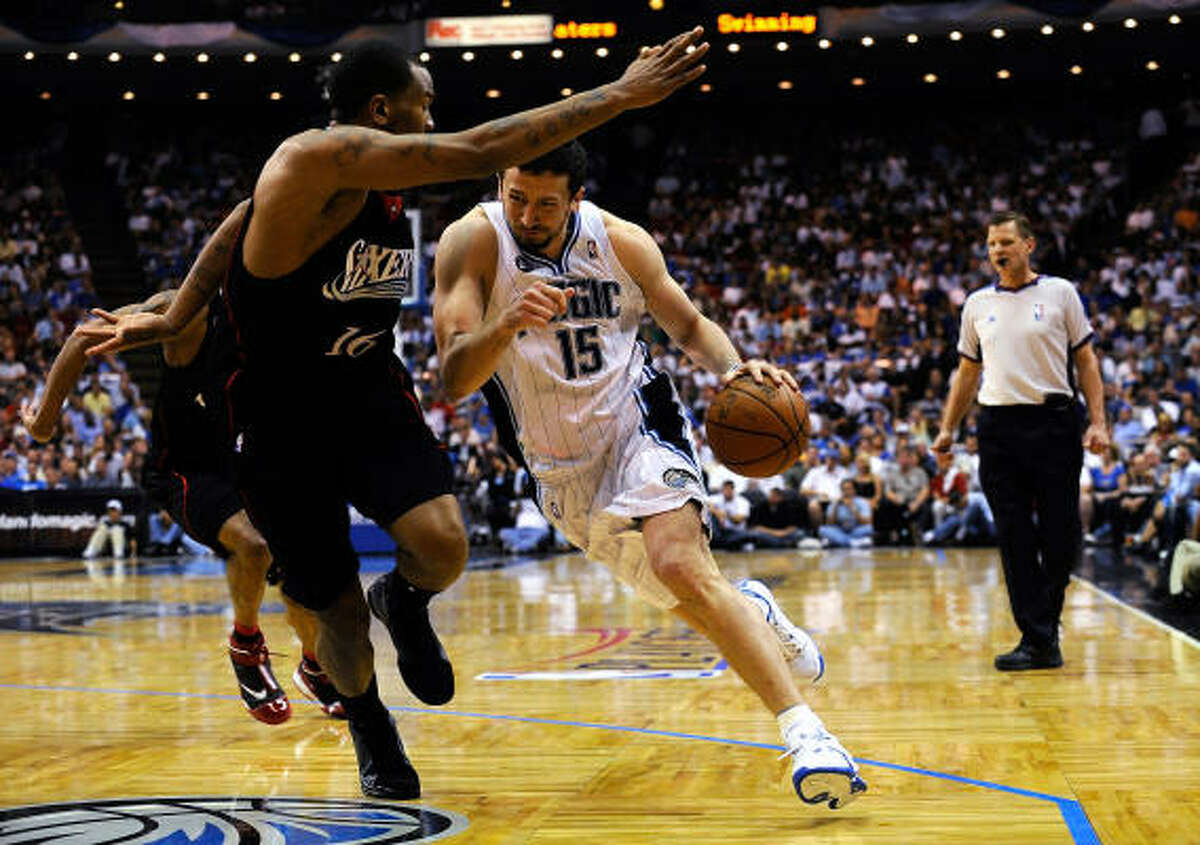 Hedo Turkoglu of the Orlando Magic drives against Marreese Speights of the Philadelphia 76ers. The Magic beat the Sixers 96-87 to make the series tied 1-1.