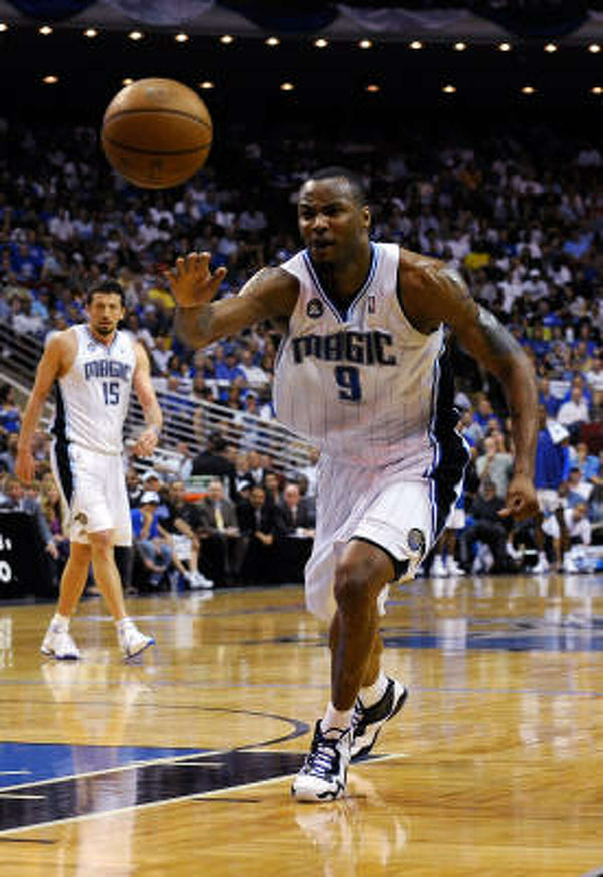 Rashard Lewis of the Orlando Magic reaches for a loose ball against the Philadelphia 76ers. The Magic beat the Sixers 96-87 to make the series tied 1-1.