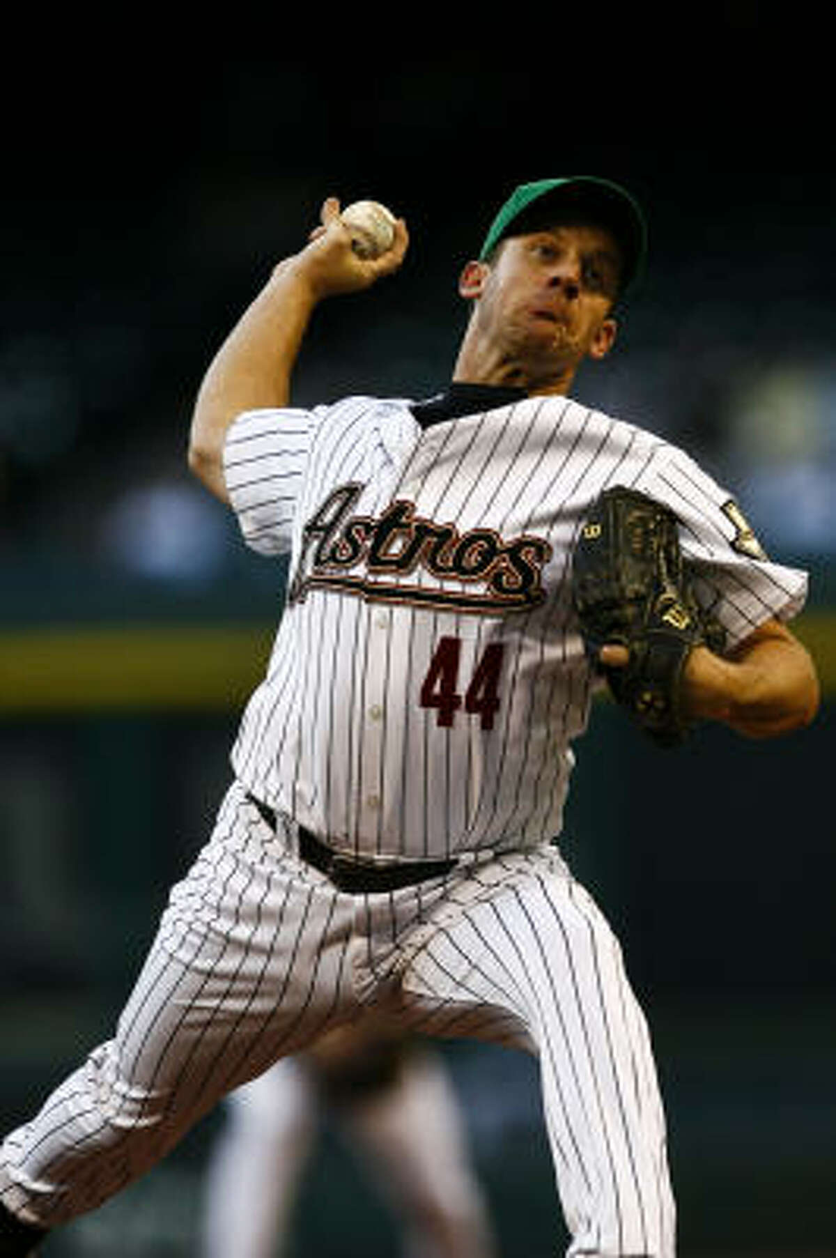 Astros starting pitcher Roy Oswalt throws a pitch during the first inning.