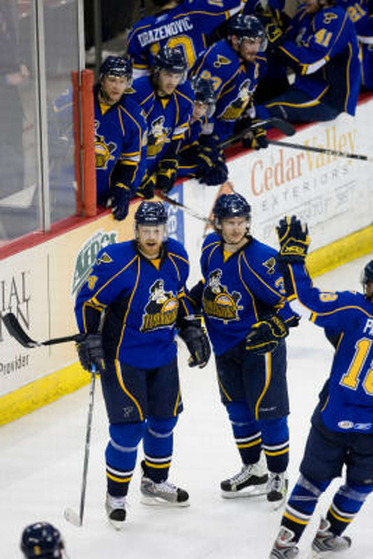 The Peoria Rivermen celebrate after scoring the game's first goal in the second period.