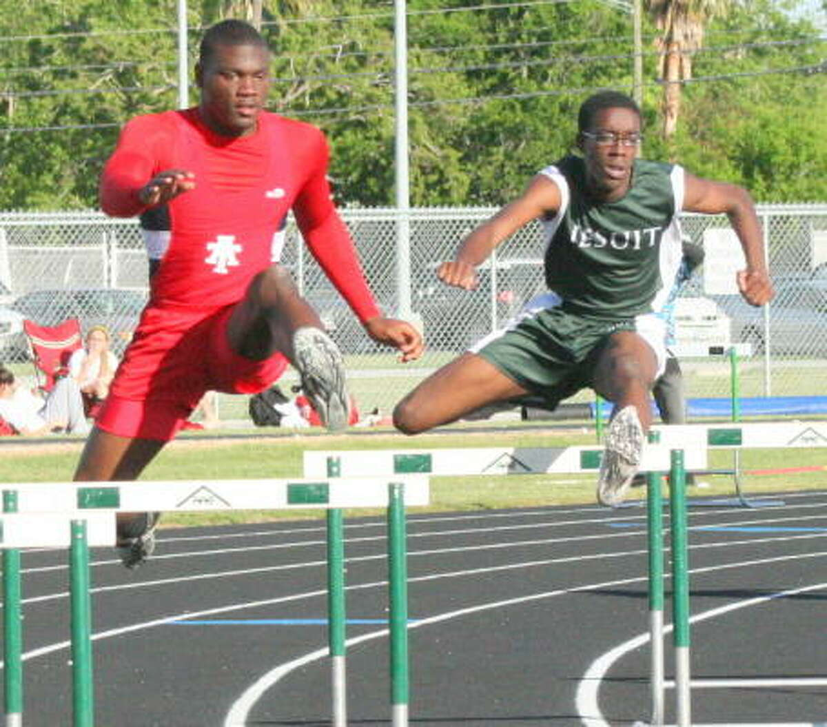 Alief Taylor's Mack Gannon (left) and Strake Jesuit's Mike Collins in action.