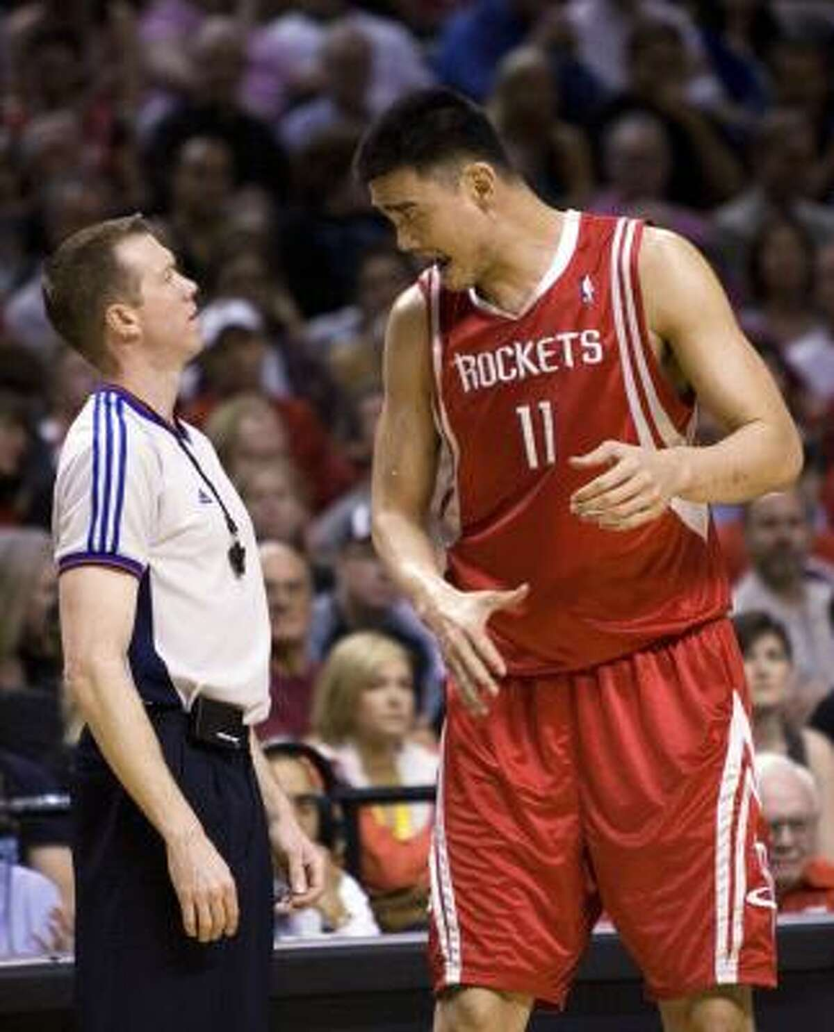 Rockets center Yao Ming, right, from China, complains to referee Ed Malloy during the first half.