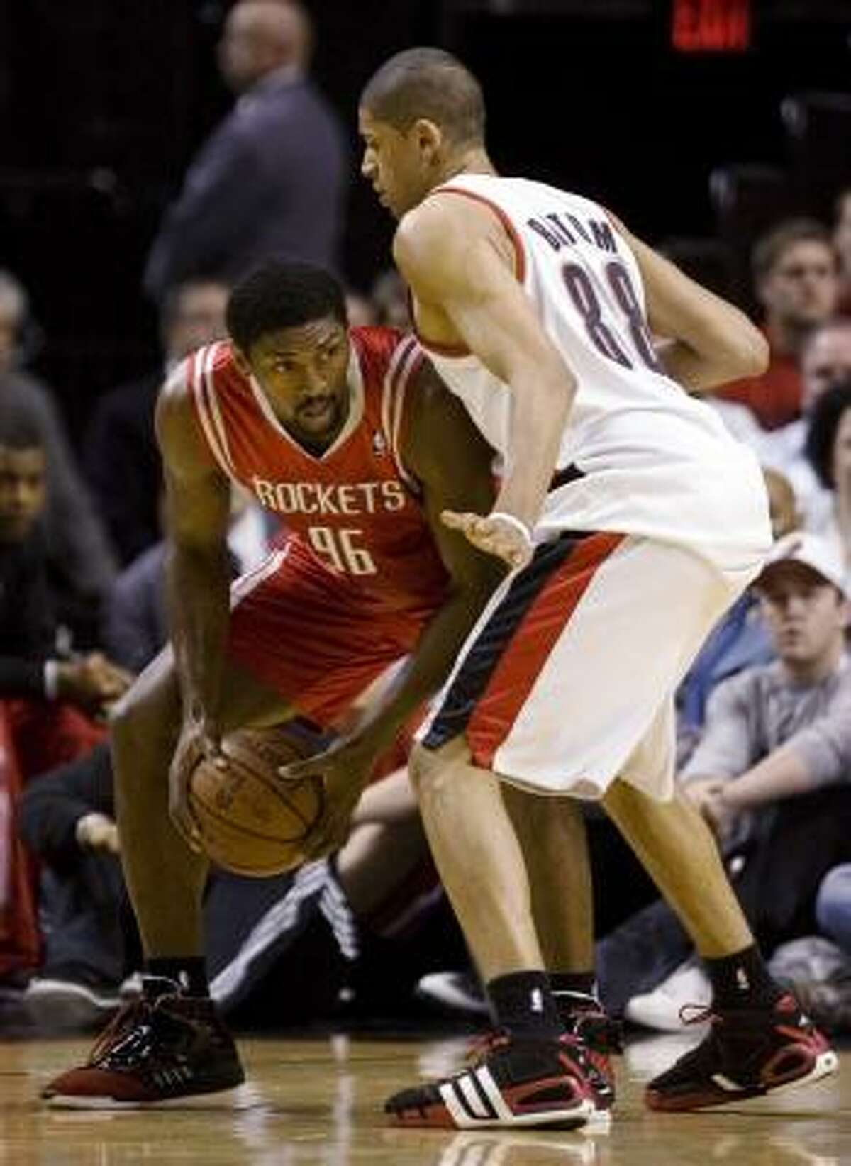 Rockets forward Ron Artest, left, looks for room to maneuver against Portland Trail Blazers forward Nicolas Batum during the first half.