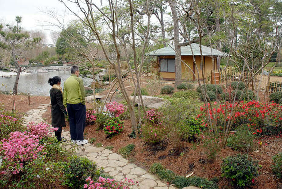 Patrick and Atsuko McEnroe admire the updated Japanese Garden in Hermann Park Feb. 28, 2009. Photo: Dave Rossman, For The Chronicle