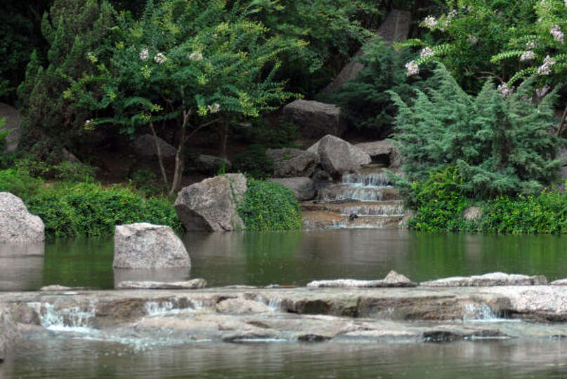 A Waterfall At The Japanese Gardens In Hermann Park